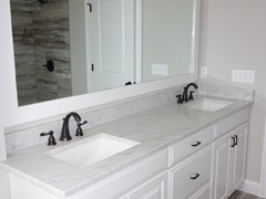 Double vanity with standard custom-made granite countertop, available in many colors.