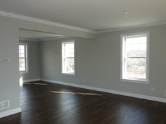 Natural hardwood floors and crown molding is standard in all public rooms.