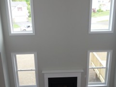 Gas fireplace and two story windowed wall in family room