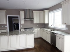 Kitchen featuring granite countertops and upgraded cabinets