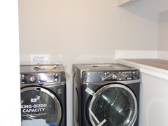 Large laundry room conveniently located upstairs with the four bedrooms.