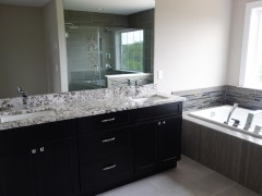 Master bathroom with double vanity and granite countertop
