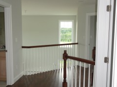 Second floor balcony overlooking large family room
