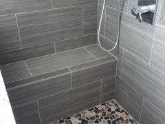 Tile floor and bench in master shower