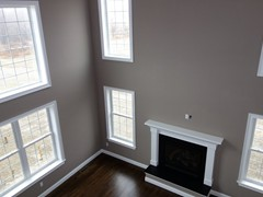 Two story family room with gas fireplace and hardwood floors