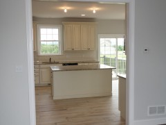 View of kitchen island from the dining room
