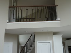 View of second floor balcony overlooking the family room